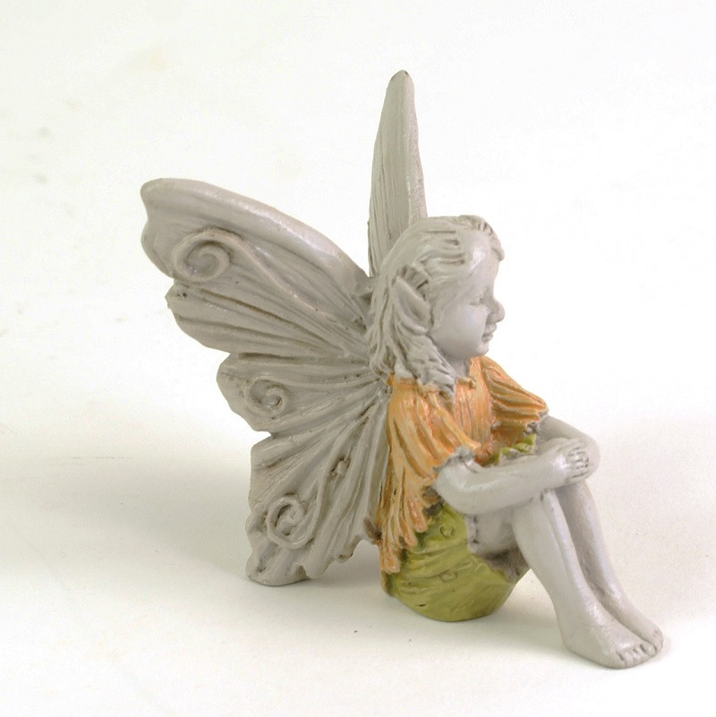 Miniature Fairy with hand on Knees